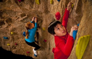 Visitors test their mountaineering ability with a horizontal climb around a rock wall. By measuring height and arm span, then plotting the results of ratio of arm span to height on a scatter plot, they can determine how efficient they are as rock climbers compared to others.